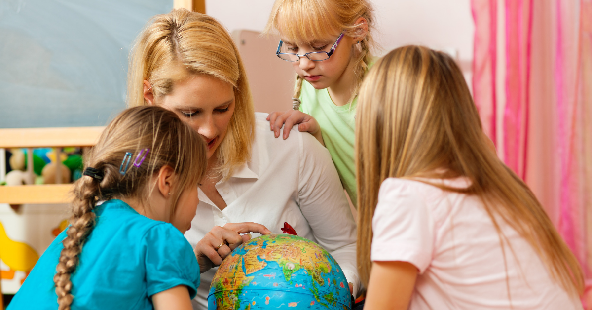 Mother showing children places on a globe