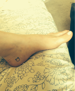 tatuaje gato tobillo