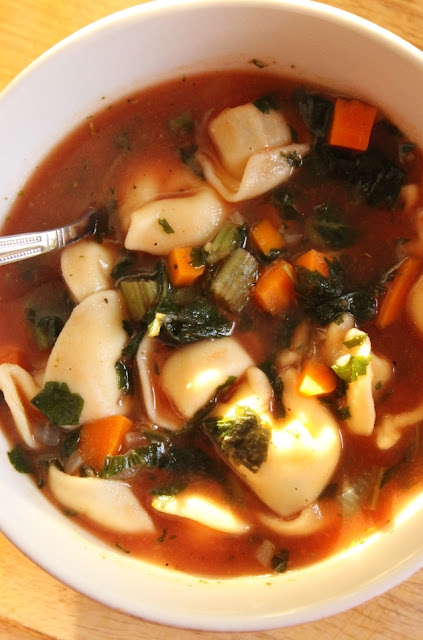 Try the Tortellini Soup! Just be sure to add the kale. It's earthy flavor makes it taste like an extra good minestone!