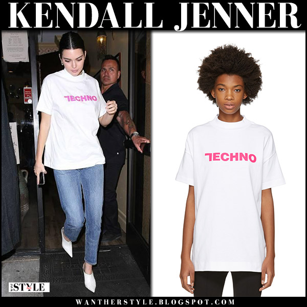 Kendall Jenner in white techno slogan tee alyx, jeans and white shoes celine street fashion celebrity model october 26 2017