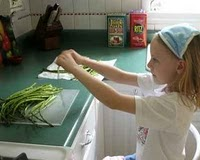 Snapping asparagus for Gorgeous Raw Asparagus Salad, another simple seasonal salad ♥ AVeggieVenture.com.