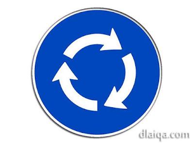 rambu: wajib mengikuti arah bundaran