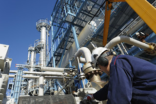 engineer working on pump and piping system oil refinery