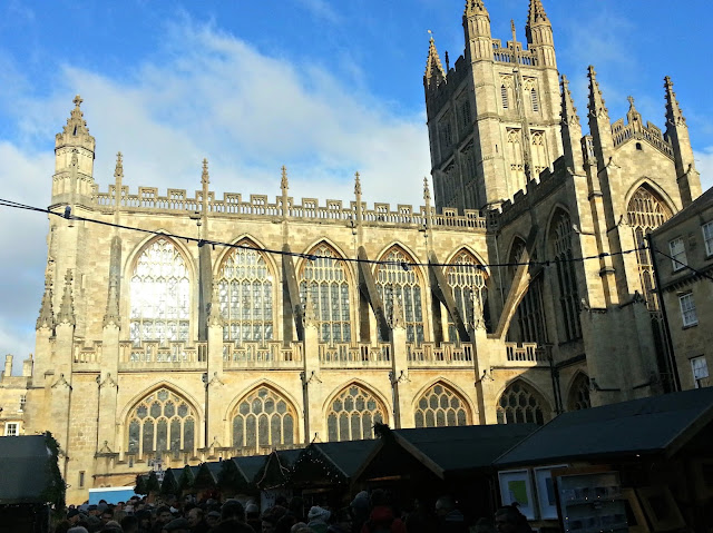 Bath Abbey with Christmas Market stalls in the foreground