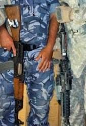 Photo of AK-47 and AR-15 assault rifles with caption Pro Gun Control Arguments: Assault Rifles