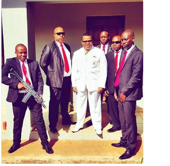 Check out this pastor and his bodyguards + deep caption