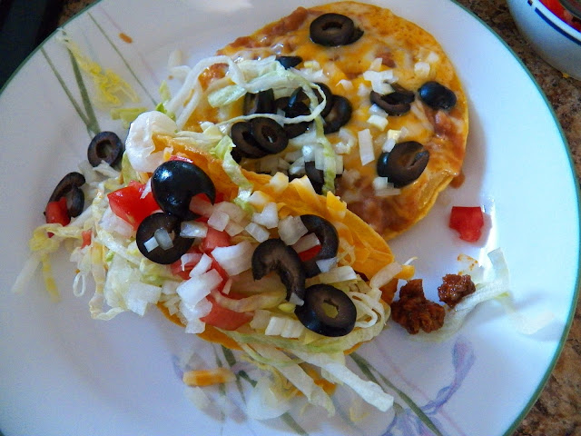 Tostada with Cheese, Onions and Olives and a Taco