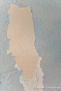 Cramer Imaging's photograph of a dirty and damaged wall example with peeling light blue paint