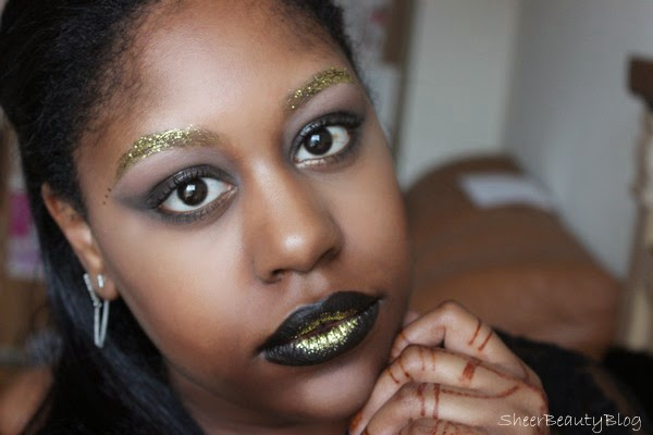 Gold Glitter makeup look with gold brows
