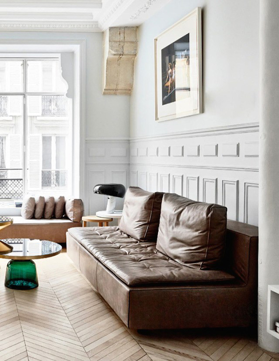 Parisian living room with Sofa by Zanotta, Bell Coffee Table by Sebastien Herkner, Snoopy Table Lamp By Achille and Pier Giacomo Castiglioni. Photo by Birgitta Wolfgang for Elle Decoration