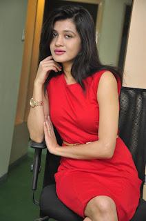 Kimaya Stills in Red Dress at DJ Lemon Holi Poster Launch