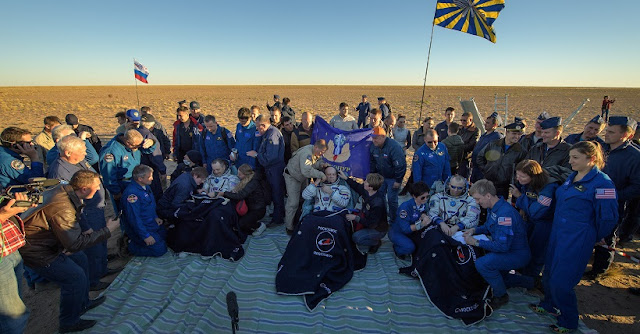 space station crew returns to earth lands safely in kazakhstan