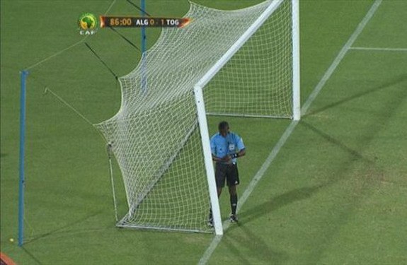 A near collapse of the goalpost on the Togo end of the field forced the referee to halt the game