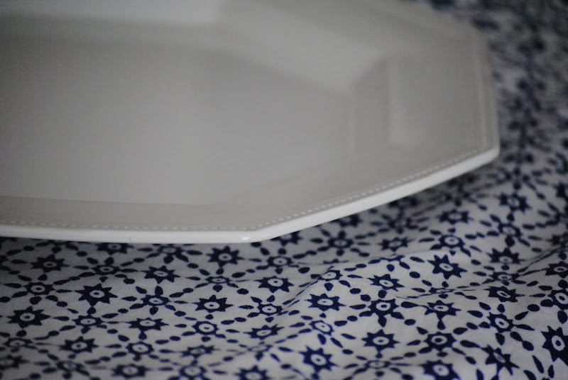 Beautiful vintage white china on a blue and white tablecloth