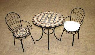 juego mesa y sillones terraza forja