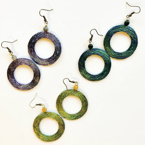 circular paper earrings in green, purple, and blue-green