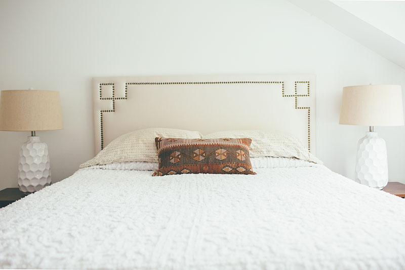 Queen Bed with White Chenille Bedspread and Kilim Lumbar Pillow
