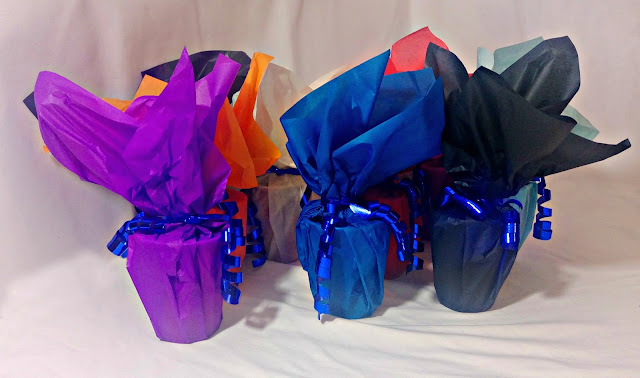 A collection of home-made colourful party bags.