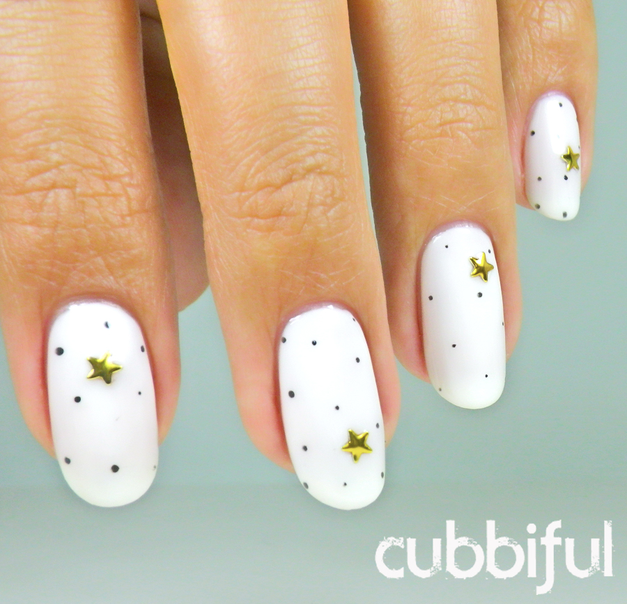 Polka dots and star studs nails