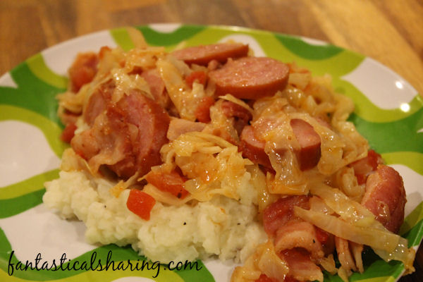 Spicy Cabbage with Kielbasa and Mashed Potatoes // A deliciously filling comfort meal with a little heat added to the cabbage and kielbasa that are served over the top of the mashed potatoes. #recipe #cabbage #kielbasa #maindish