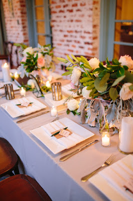 candle lit centerpieces on tables
