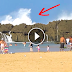 Un val gigant se sparge de malul stâncos al unei plaje din Puerto Rico.