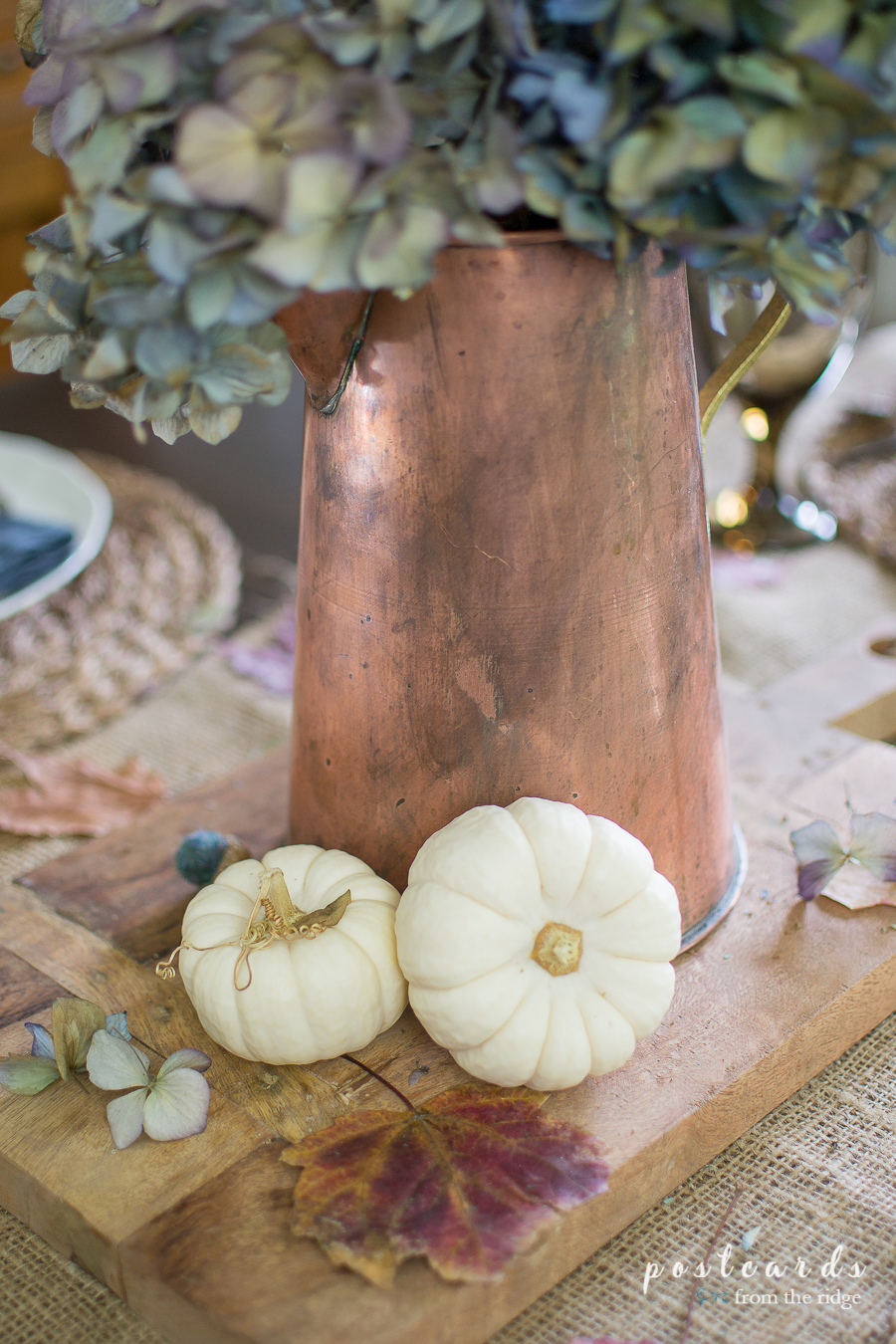 copper pitcher and baby boo pumpkins