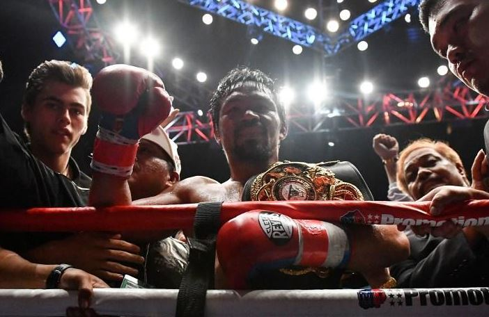 Pacquiao wins WBA Welterweight title with 7th round KO of Matthysse
