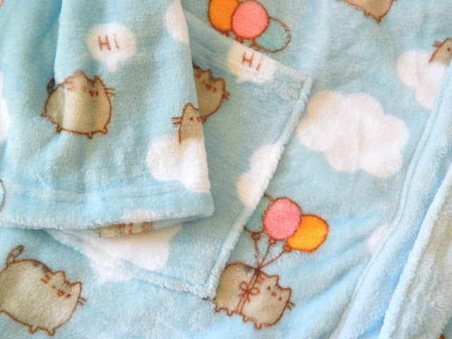 A photo showing the dressing gown design from the Pusheen Box Autumn 2018