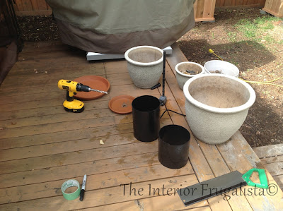 Materials used to make a water fountain from plant pots
