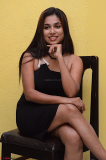 Vrushali Gosavi in strapless Short Black Dress At Follow Follow U Audio Launch 019.JPG