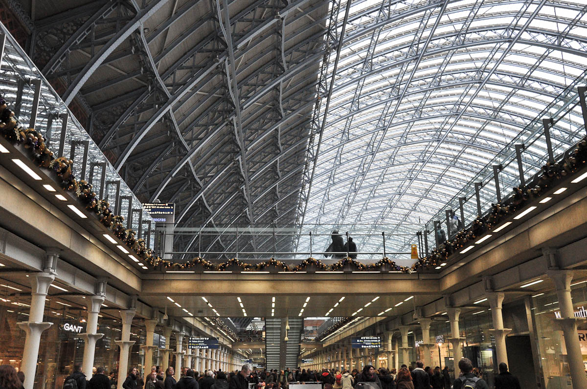 The crowds and the roof of St. Pancras International Train Station, London, England