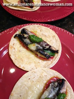 Smoked Portobello Mushroom Tacos with Fresh Tomato Slices, Cilantro Pesto, and Toasted Asiago Cheese
