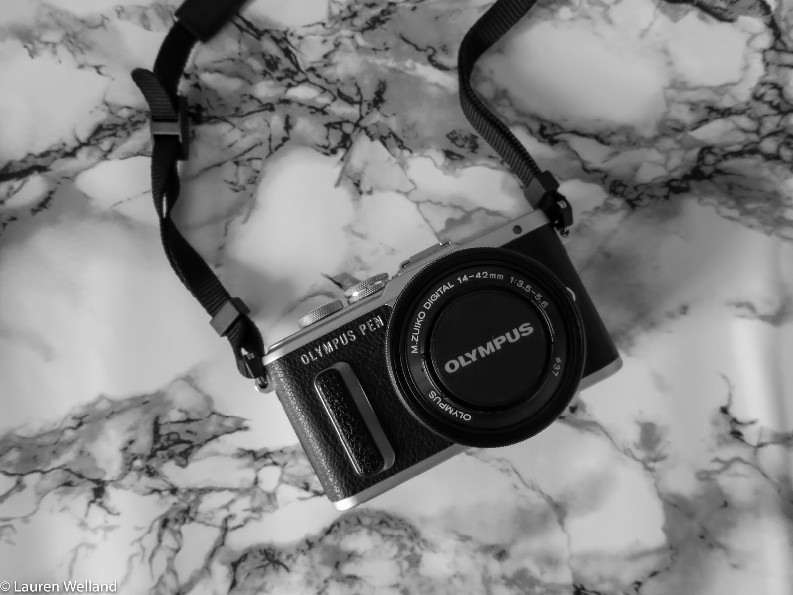 Photos of the new Olympus Pen - E-PL8 in black and silver with the M.ZUIKO DIGITAL ED 14‑42mm 1:3.5‑5.6 EZ Pancake lens