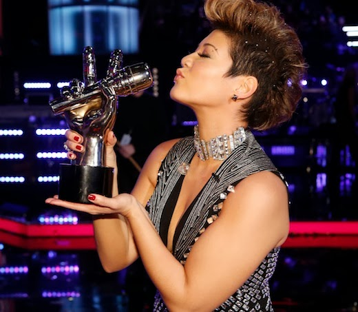 The Voice winner Tessanne Chin holding the winning trophy