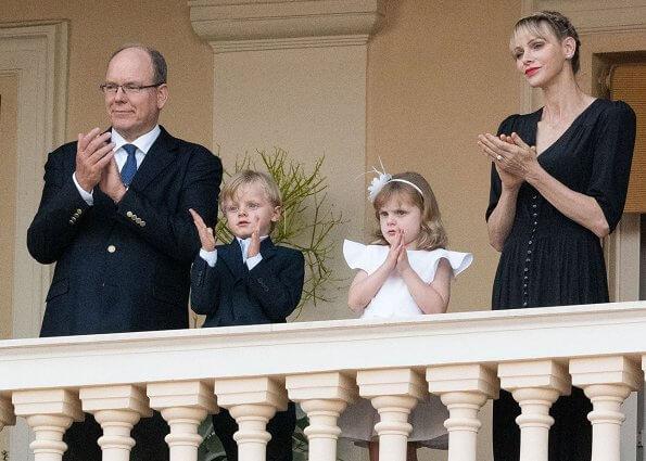 Hereditary Prince Jacques and Princess Gabriella. Princess Charlene wore a new Brunello Cucinelli v-neck midi dress. Louis Vuitton dress