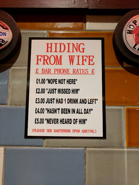 Funny Hiding From Wife Sign Joke Picture