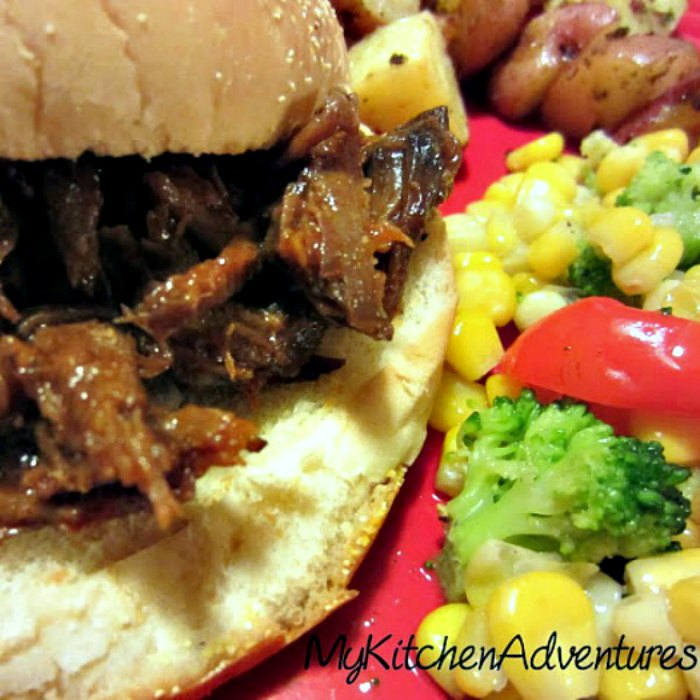 Slow Cooker BBQ Beef on bun with veggies on the side
