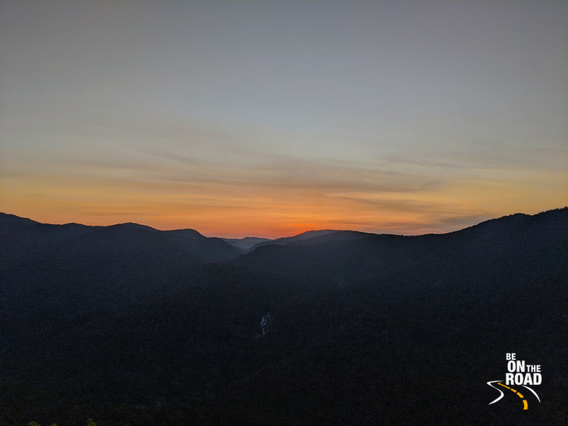 Stunning sunset over the mist covered Sahyadri mountains with the Bilihole waterfalls in the far foreground