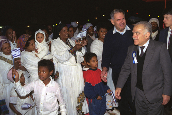 Israeli PM Yitzhak Shamir greets new immigrants from Ethiopia, 1991. (Photo by Government Press Office)