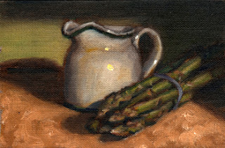 Oil painting of a white porcelain milk jug beside a bunch of asparagus.