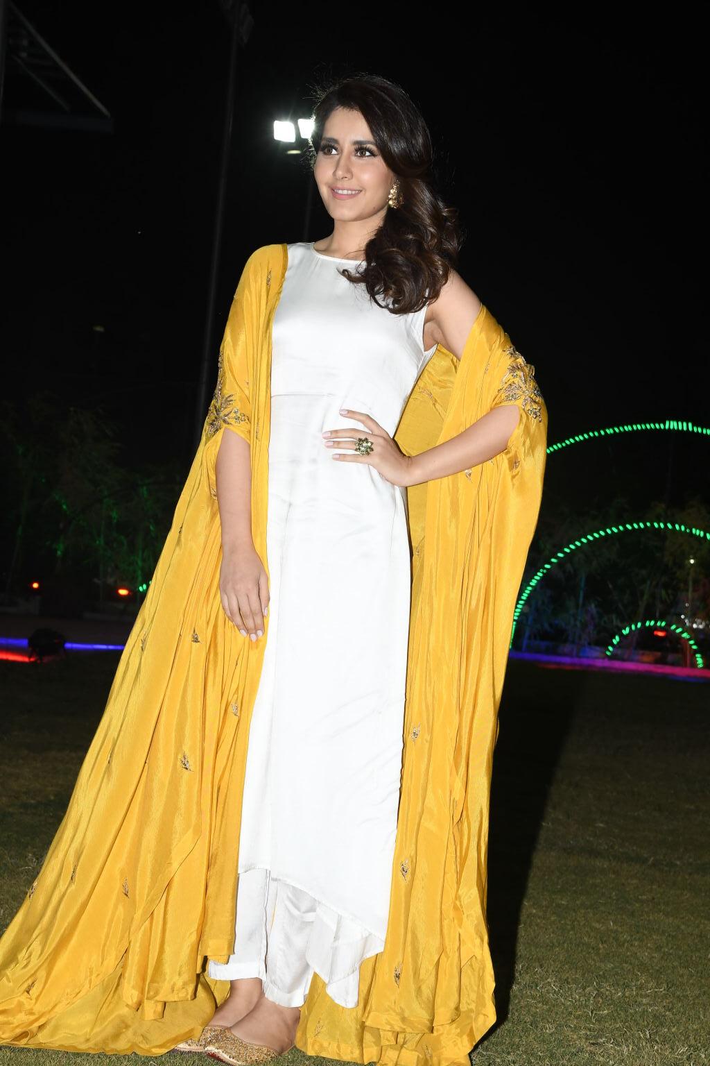 Raashi Khanna in a Long Yellow White Dress at Balakrishnudu Movie Audio Launch
