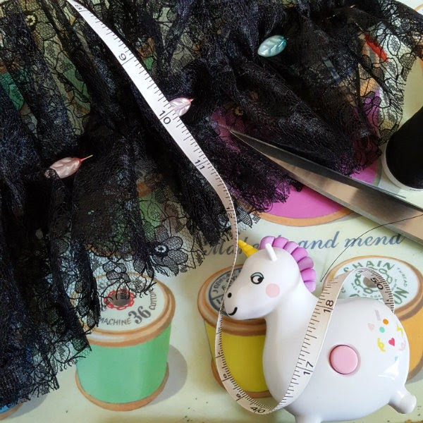 sewing materials, scissors, tape measure and lace