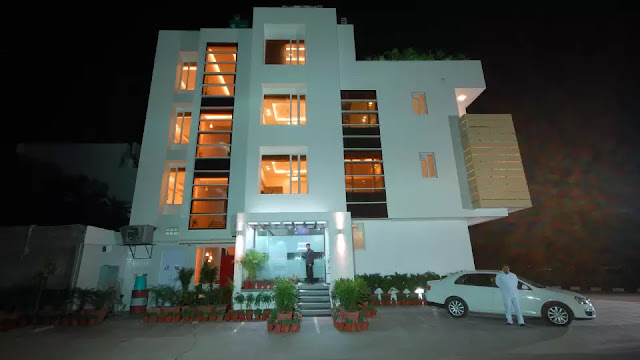 Hotel Naangi's Pride - Jaipur B-13, Siddharth Nagar, Near Jawahar Circle, Airport Rd, Jaipur, Rajasthan 302017 For Booking Contact us on 9427703236 / 8000999660  Along with complimentary Wi-Fi, Hotel Nangis Pride houses capacious banquet hall which accommodates about 100 individuals to host banqueting and conferencing facilities. This hotel in Jaipur is located in the heart on the city and is situated 11 km from the Jantar Mantar - Jaipur.  The Jaipur International Airport is 1 km away from this property.The property accommodated 18 well-maintained and comfortable rooms to choose from. A workstation, air-conditioner, grooming mirror, a closet, premium bedding, electric kettle and LCD TV are few on the amenities offered in the room.  This hotel in Jaipur offers services like laundry, dry cleaning, room service and transportation service. This property has a multi-cuisine restaurant for guests to enjoy mouth-watering delicacies. Free parking is also available on the premises.The Jaipur Railway Station is 12 km away and the Shastri Nagar Bus Stand is 14 km away from the Hotel Nangis Pride.  Places worth visiting are City Palace (11 km), Albert Hall Museum (9 km), Hawa Mahal (11 km) and Amber Palace (24 km)  International Air Tickets || Domestic Air Tickets || Cruise Booking || International& Domestic Packages || Hotel Booking World Wide ||  Visa Services || Passport Services || Overseas Travel Insurance || Railway Ticket || Bus Ticket ||  Car Rental || Foreign Exchange || Western Union & Transfast Money Transfer Services & More...  Ground Floor-11, Vishwas Shopping Center Part-1, R.C.Technical Road, Ghatlodia, Ahmedabad - 380061. Contact No.: 8000999660, 9427703236, 9408669502 E-mail : travel@aksharonline.com, info.akshar@gmail.com