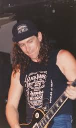 Spike Cassidy of DRI wearing a Jack Daniel's T-shirt