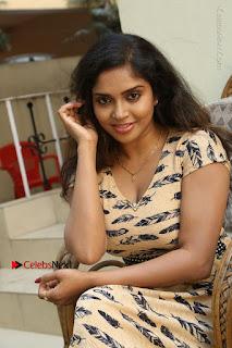 Telugu Actress Karunya Chowdary Stills in Short Dress at ATM Not Working Press Meet  0161.jpg