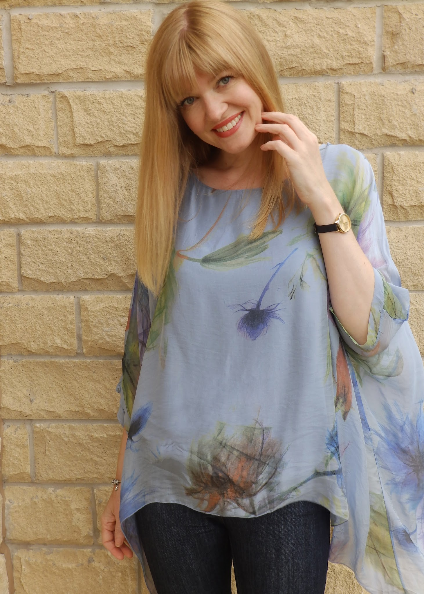 Over 40 blogger What Lizzy Loves wears blue silk flower top, skinny jeans and nude ballerinas