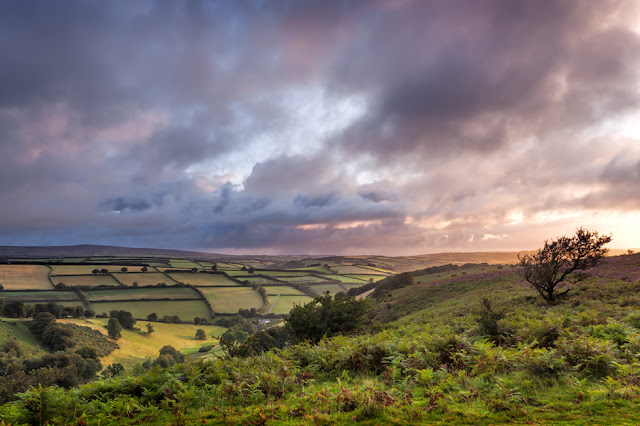 Pink clouds and patchwork fields at the Punchbowl near Winsford in Exmoor