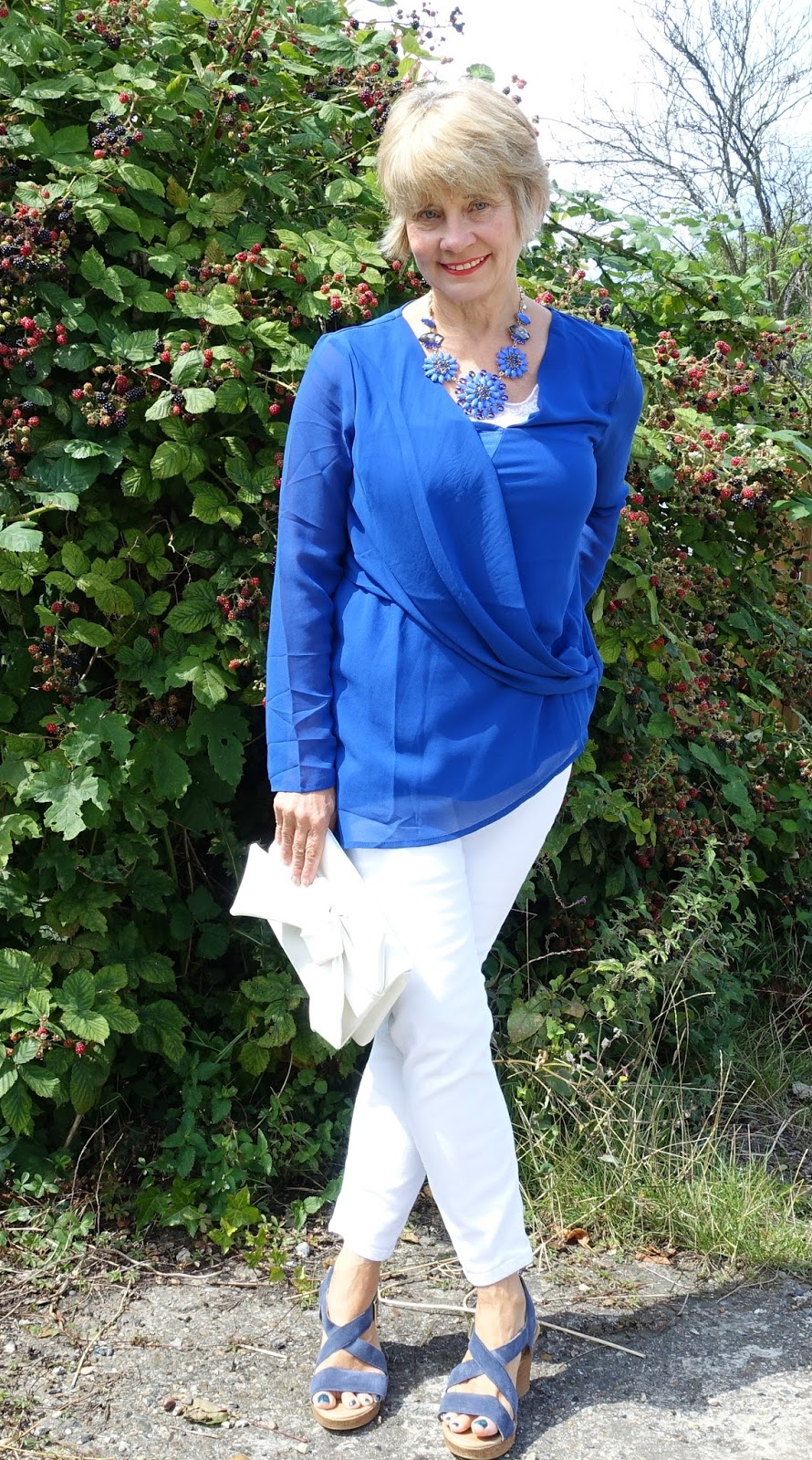 A drapey cobalt blue top will take you anywhere: wear with white jeans for a casual vibe or add palazzos for evening