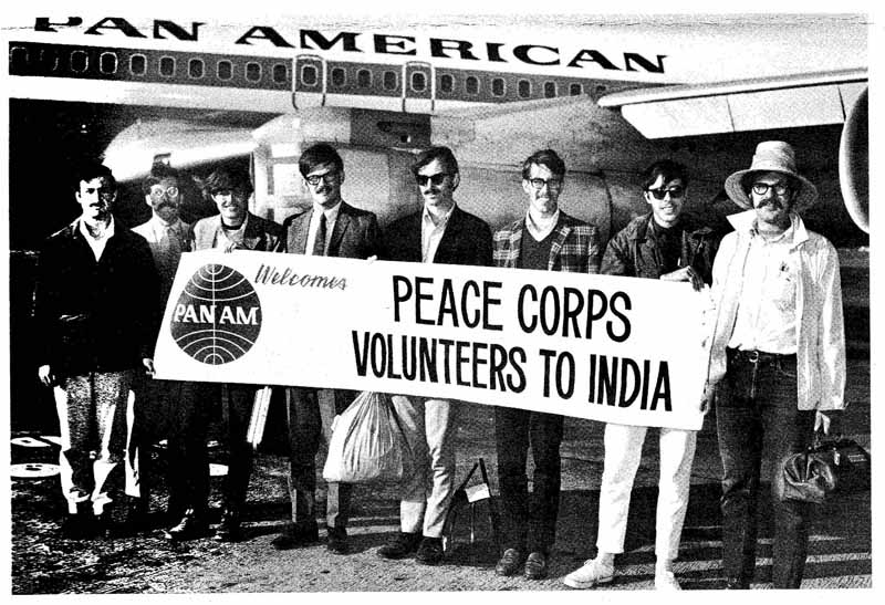 India Peace Corps Volunteers standing in front of Pan Am 707 jet